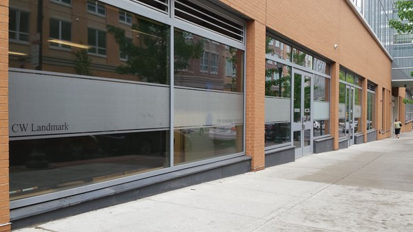 Digital and frosted vinyl used to brand the street side glass walls